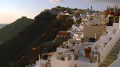 Fira Santorini Taverna's at sunset on the cliffs of the caldera - stock footage