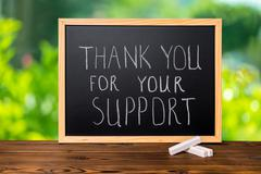 handwriting text thank you for your support is written in chalkboard on green - stock photo