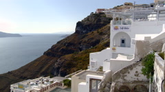 Fira Santorini Taverna on cliff with cable cars moving up in background Stock Footage