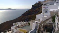 Fira Santorini Taverna on cliff with cable cars in background Stock Footage