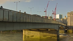 London Bridge, side angle view, boat crossing under the bridge Stock Footage