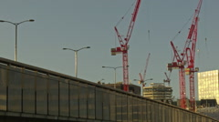 London Bridge, side angle view, cranes in the background Stock Footage
