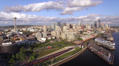 Aerial Flight Over Downtown Seattle Waterfront with City Buildings and Train Stock Footage