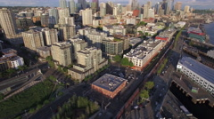 Aerial Flyback to Reveal Waterfront and Downtown Seattle Washington on Sunny Stock Footage