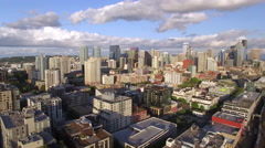Aerial Pan of Amazing Cityscape with Downtown City Buildings and Blue Sky - stock footage