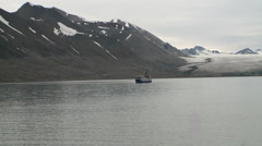 Tourist boat sailing along the coast. Svalbard. Stock Footage