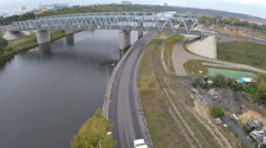 Flying over railway bridge and car traffic Stock Footage