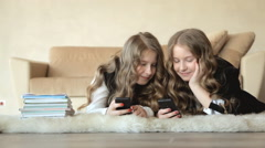 Twin sisters communicate through phones Stock Footage