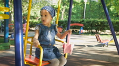 Little girl on a playground. Child playing outdoors in summer. Children having Stock Footage