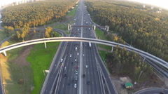 Flying over motorway in city outskirts Stock Footage