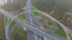 Flying over city traffic on transport intersection Stock Footage