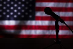 American flag in the darkness. Stock Photos