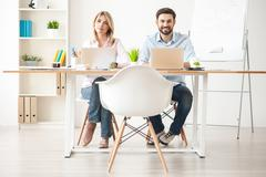 Talented two colleagues are doing their work - stock photo