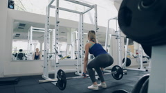 Sexy girl doing deadlifts with a barbell in gym Stock Footage