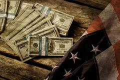 Old USA flag and dollars. Stock Photos