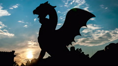 Ljubljana. Sunset. Silhouette of a dragon statue, a symbol of the city Stock Footage