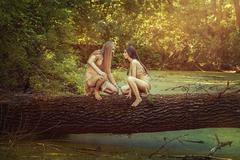 Wild men in the woods. - stock photo