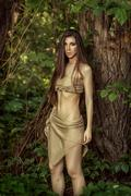 Savage girl in the woods. - stock photo