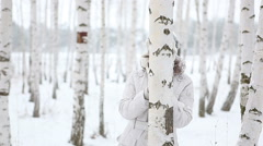 Woman playing in snowballs - stock footage