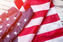 Creased flag of USA. - stock photo
