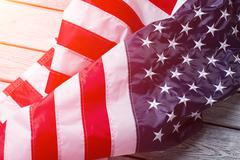 Creased American flag in sunlight. Kuvituskuvat