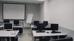 Classroom with computers. Steadicam fly thru auditorium - stock footage