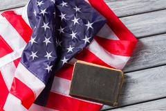 US flag beside old book. Stock Photos