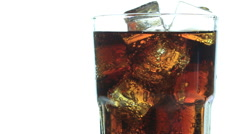 Cola with Ice and bubbles in glass. Soda closeup. Food background Stock Footage