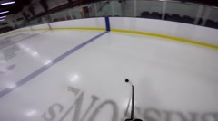 Hockey player helmet cam nifty deke move Stock Footage