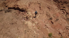 Climber in the mountains, moving towards the goal. Aerial view Stock Footage
