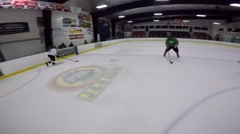 Hockey gopro helmet cam shoot puck and get tripped Stock Footage