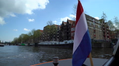 Touring Amsterdam's Canals by Boat in 4K Stock Footage