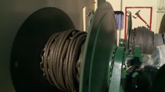 Winch pulls the network on a fishing trawler - stock footage