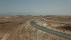 Development of inaccessible places. Road construction in the desert - stock footage