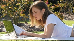 Intellectual diligent student woman studying outdoors on laptop computer - stock footage