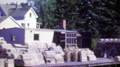 1964: Empty fishing crab traps on dock piers ready for hunting season. Stock Footage