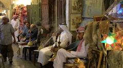 Men smoking Sheesha pipes in cafe at Souq Waqif, Doha, Qatar - stock footage