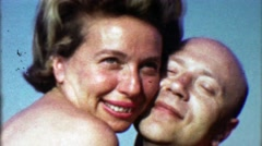 1963: Caucasian lovers embrace summertime bikini tops joy. Stock Footage
