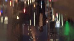 Urban street scene of black man standing on sidewalk Stock Footage