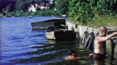 1963: Hairy old men climbing out of Thames River after a smelly swim. Stock Footage