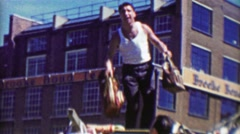 1963: Gregarious Italian merchant throwing handbag purses into crowd. - stock footage