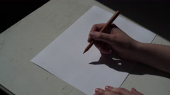 4K hand writing Brown on a white paper with brown pen Stock Footage