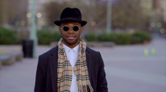Happy young black man with hat wearing cool style Stock Footage