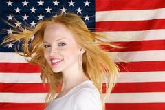 Beautiful teen girl against american flag - stock photo