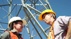 Electrical High Tension Pole Male Female Workers Low Angle Stock Footage