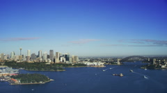 Aerial Sydney Harbour approaching Sydney Harbour Bridge and the Opera House Stock Footage