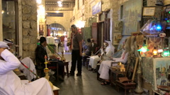 Men smoking Sheesha or water pipes in cafe at Souq Waqif, Doha, Qatar Stock Footage