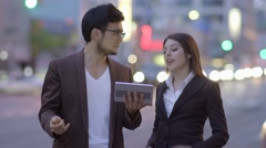 Lifestyle portrait of two young people talking together in the city Stock Footage