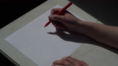 4K woman writing I LOVE YOU with red felt pen and draw many hearts - stock footage