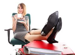 Woman work stoppage businesswoman relaxing legs up plenty of documents isolat Stock Photos
